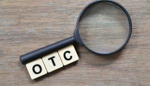 Die Buchstaben OTC und Lupe