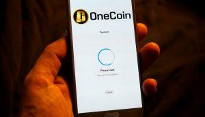 OneCoin Symbol auf Handy